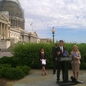State of the World's Fathers co-author Michael Kaufman speaks to the press outside of the US Capitol. Credit: Promundo-US