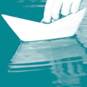 An abstract teal and white image of a hand holding a toy boat.