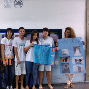 Six youth participants hold posters as part of Promundo's Shameless Campaign.