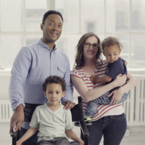 "A family looks at the camera in a still from ""America's Dads."""